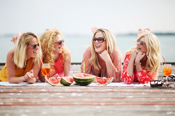 Women enjoying beautiful summer day at lake
