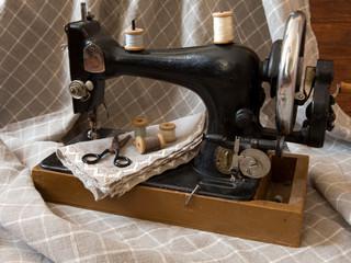 An old antique sewing machine, thread, scissors