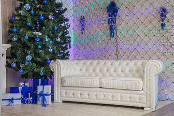 Christmas interior with white sofa in blue color.