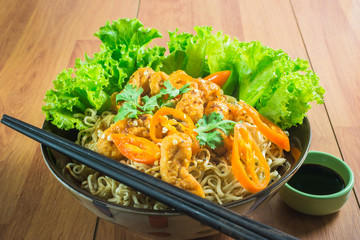 Focus Spot Noodle chicken nuggets page on the table. Noodles fusion food with a difference.