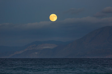Golden moon over the sea