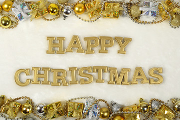 Happy christmas golden text and Christmas decorations on a white