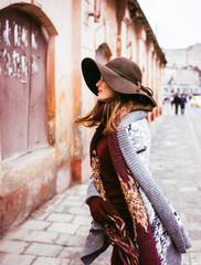 happy woman posing  near old city walls