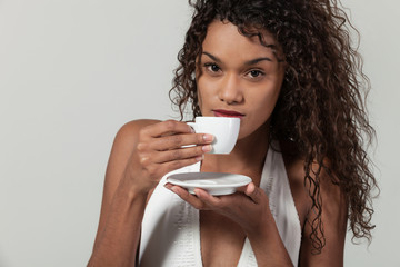 Portrait of a girl with a cup of coffee