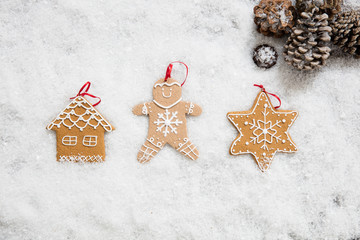 Christmas holiday symbols on winter snow wallpaper, top view