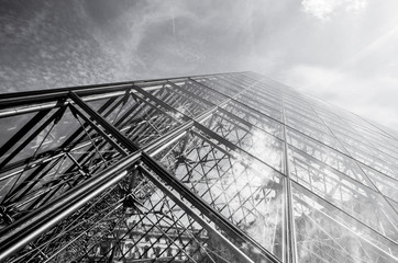 PARIS, FRANCE - 02 SEPTEMBER, 2015: Building of Louvre in Paris, France. The museum is one of the world's largest museums and a historic monument. A central landmark of Paris. Black-white photo.