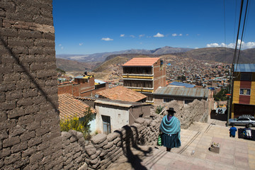 Potosi, Bolivia - November 29, 2013: Woman wearing traditional clothes in the city of Potosi in Bolivia.