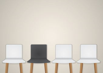 Chairs in modern design arranged in front of the gradient grey w