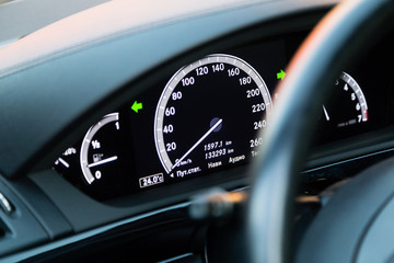 Interior of the luxury car of famous german vendor. Electronic LCD display with speedometer and othe indicators.