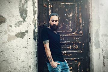Portrait of brutal bearded man wearing blank t-shirt
