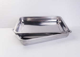 tray or metal baking tray on background.