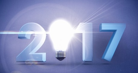Composite image of 2017 with glowing light bulb over white backg