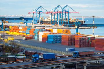 cargo terminal in the sea port wit bridge and trucks