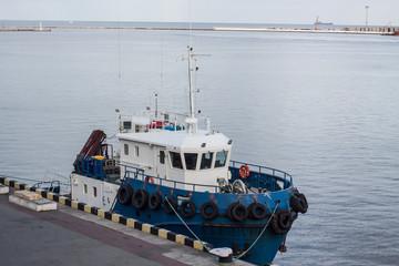 tow ship in the sea port
