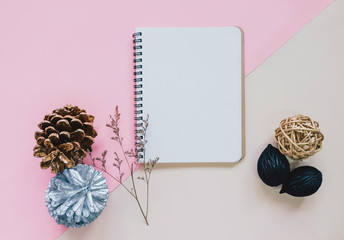 Creative flat lay of craft and blank notebook mock up on colorfu