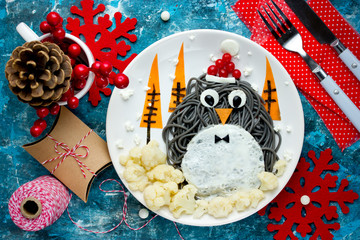 Fun food art idea for kids - penguin black spagehetti