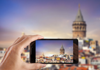 Travel concept. Hand making photo of city with smartphone camera. Istanbul. Turkey