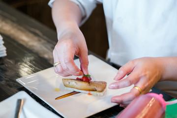Chef  prepare foie gras dish
