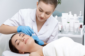 Doctor doing beauty procedure for patient