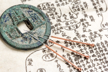 Acupuncture needles and ancient medicine book