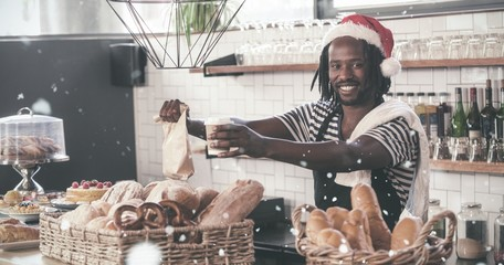 Composite image of smiling hipster employee serving take away pr
