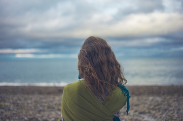 Young woman looking at the sea