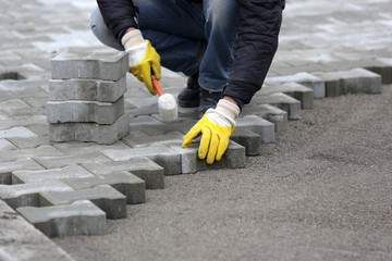 Paving stone worker