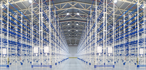 Empty huge distribution warehouse with high shelves
