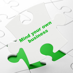 Business concept: Mind Your own Business on puzzle background
