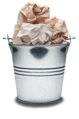 Metal trash bin with trash on a isolated white background