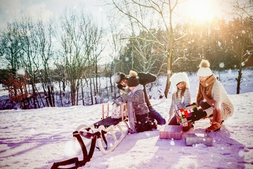 Composite image of family playing with sled