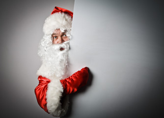 Santa Claus is pointing