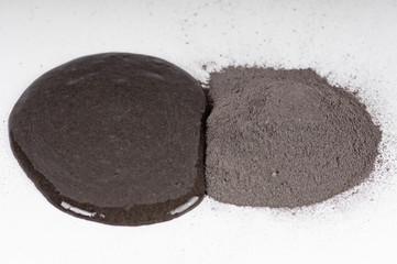 slide from black volcanic clay powder for cosmetic procedures