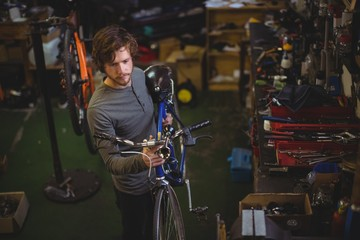 Mechanic carrying a bicycle