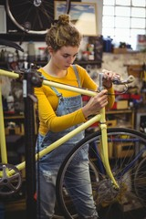 Mechanic repairing a bicycle handle bar