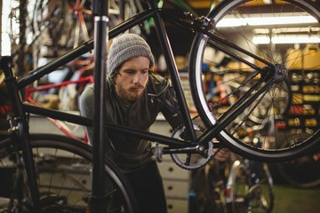 Mechanic examining a bicycle