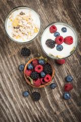 Healthy breakfast with Fresh greek yogurt, flakes and berries