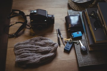 Woolly hat, camera, key, wallet, sunglasses, diary, pen