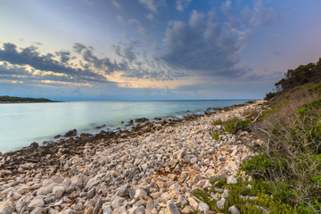 Wall Mural - Sunrise over rocky coast on Cres