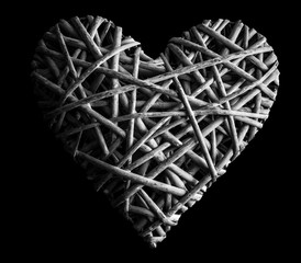(withe, withy, osier, sallow, vine) braided on a frame in the form of hearts isolated on a black background, BW photo - pictures concept theme Love and St. Valentine's Day