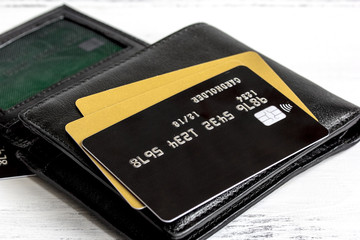 Credit cards on wooden background - online shopping