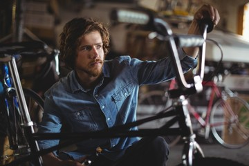Mechanic examining bicycle