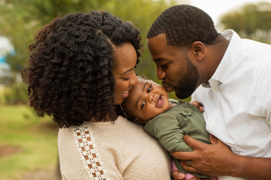 Happy family. Mother father and baby girl.