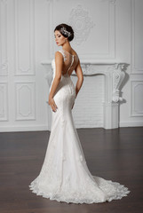 Beautiful bride in fashion wedding dress with diamond jewelry
