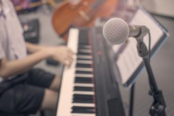 music equipment,microphone and piano player retro tone