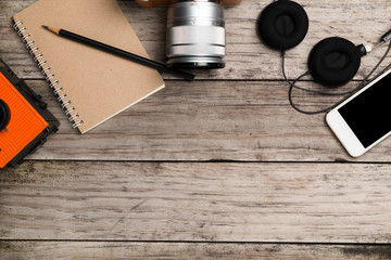 Organized modern and retro objects on wooden table.