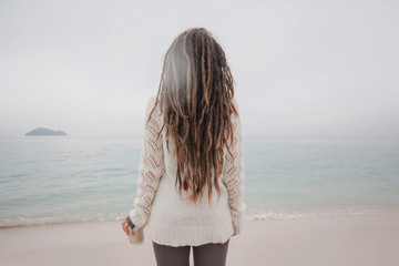 attractive young woman in sweater watch the horizon line
