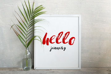 Hello january on mockup of frame poster.