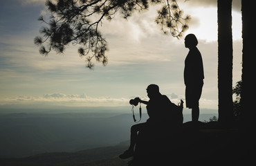 Silhouette of travellers enjoying a beautiful mountain view. the