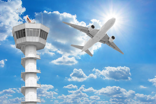 Passenger aircraft  flying above air traffic control tower agai